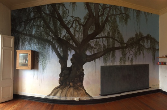 A tree to tell stories under in the nordic childrens library Libro Alegre, Valparaiso, Chile.